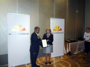Dr.Vinya receiving the 2014 Social Entrepreneurship Award from the co-founder of Schwab Foundation/World Economic Forum Mrs.Hilde Schwab